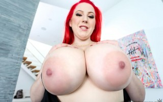 Busty redhead Kamille Amora seduces in black