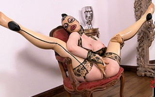 The freaky deaky Latex Lucy posing in a gold trimmed mirror!