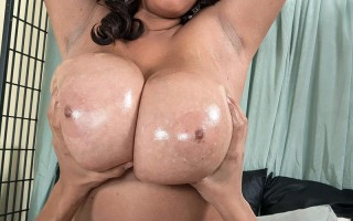 Roxi Red's massive natural tits get oiled and fucked