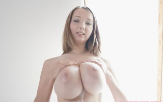 Hot busty girl plays with a big suction dildo