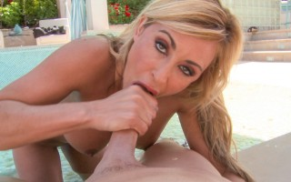 horny blonde milf sucking cock on the patio by a pool