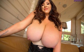 Rachel Aldana's huge melons on love seat