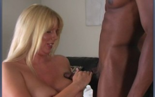Blonde MILF sucks a big black cock hard then gets her big titties fucked.