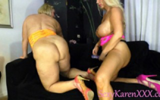 Two blonde MILF\'s fuck each other with flopping big natural titties wearing a strap on.