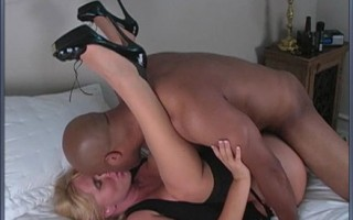 Big tittied blonde MILF in black stockings gets fucked by black dude.