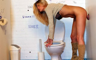 Cute blonde girl takes a quick break in a public restroom
