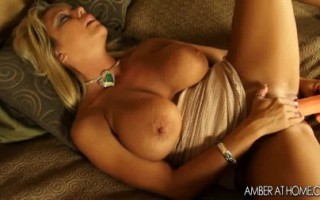 MILF Amber Lynn Bach masturbates with a big dildo.