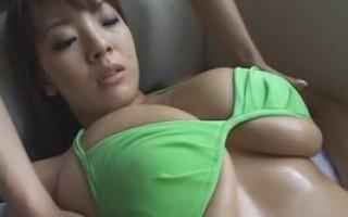 Busty asian in green bikini