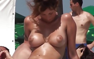 NICE BIG BOOBS ON THE BEACH