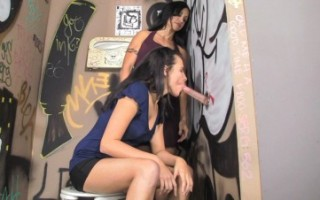 Mom teaching daughter how to suck dick through glory hole.