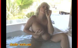 Claudia-Marie plays with her giant tits in a jacuzzi.