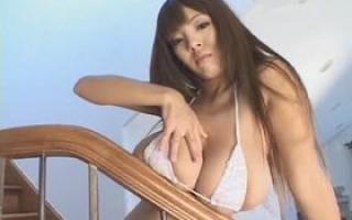 Busty asian Hitomi Tanaka posing in white bikini