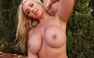 Melissa Debling slides down her rainbow top to preview her big natural wonder