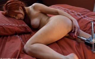 Sexy long legged red head machine fucked in her tight pussy until she buries her face in the pillow and cums.