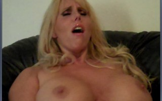 Blue eyed blonde with big tits gets her pussy fingered by MILF in red stockings.