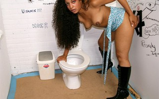Very horny girl blowing a stiff boner in a dirty toilet