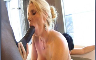 Blonde with big titties sucks then fucked hard by a huge black cock.