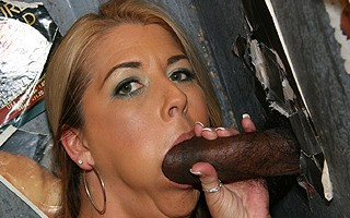 Blonde MILF sucks off black dick in gloryhole