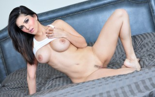Hot brunette Sunny Leone masturbates in her brand new bed