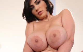 Luna Amor strips & plays with her big tasty tits and nipples