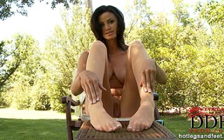 Shannon reveals her French pedicure through snug tights