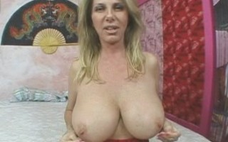 Penny Porsche posing her huge big tits in red lingerie