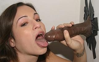 Amber Rayne sucks off black in pornshop gloryhole