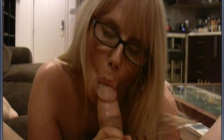 Hot blonde MILF with big boobs puts a hard big cock deep in her mouth wearing glasses.