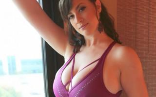 Lana Kendrick wearing a purple top in a hotel