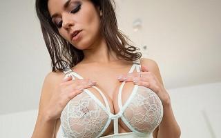 Krystal Webb's big tits underneath her coat
