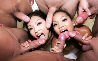 horny Asian chicks deep throat a bunch of massive cocks