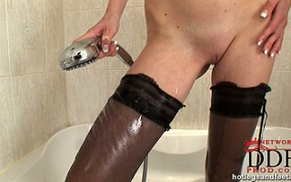 Blonde babe Samantha naked in her stockings in bathroom